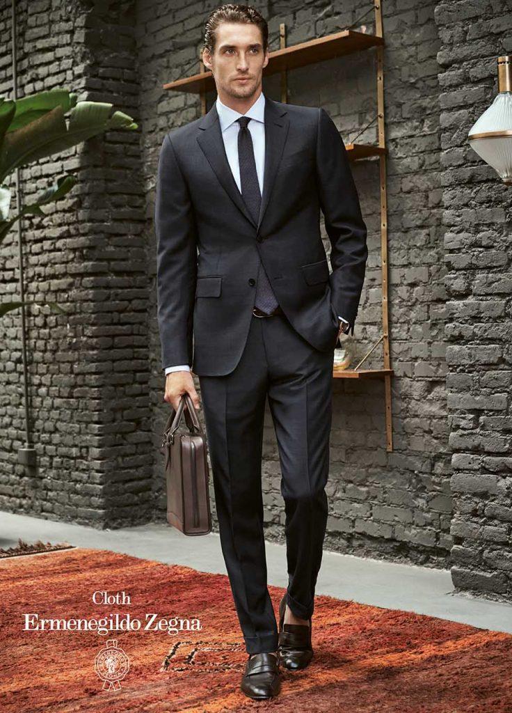 handsome business man in italian suit by ermenegildo zegna walking outside
